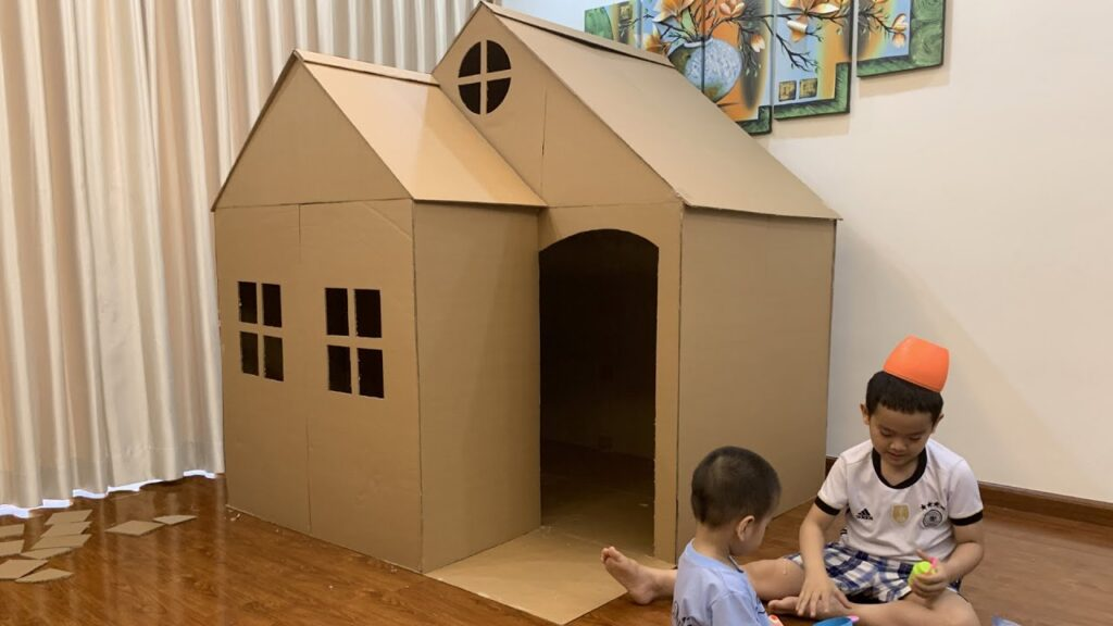 Playing Children With Cardboard House - Top 10 Tips For Entertaining Your Child In COVID-19 Lockdown